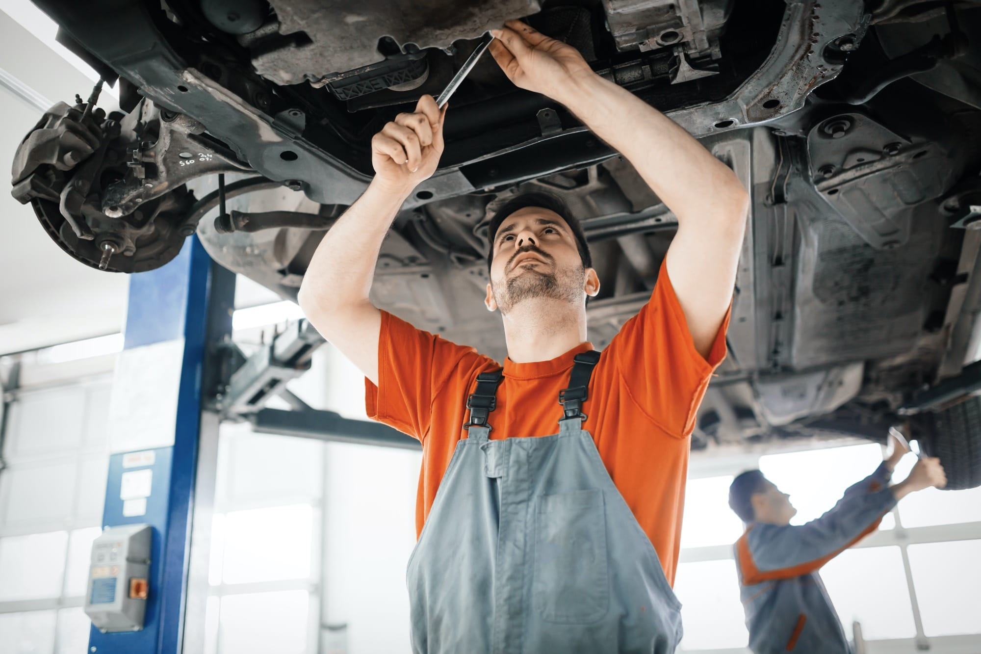 car-mechanics-working-and-maintaining-car